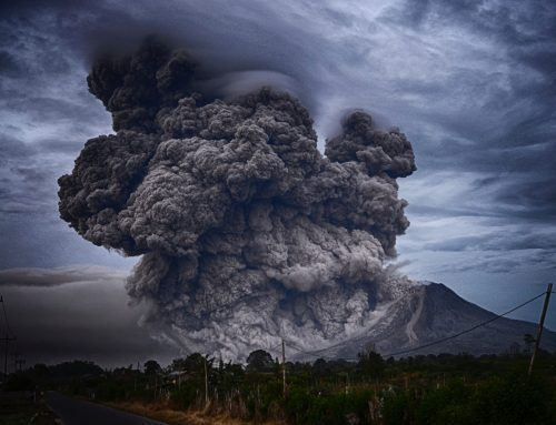 volcano erupting with pyroclastic plumes