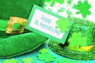 two green hats, shamrocks, and happy st patrick;s day sign
